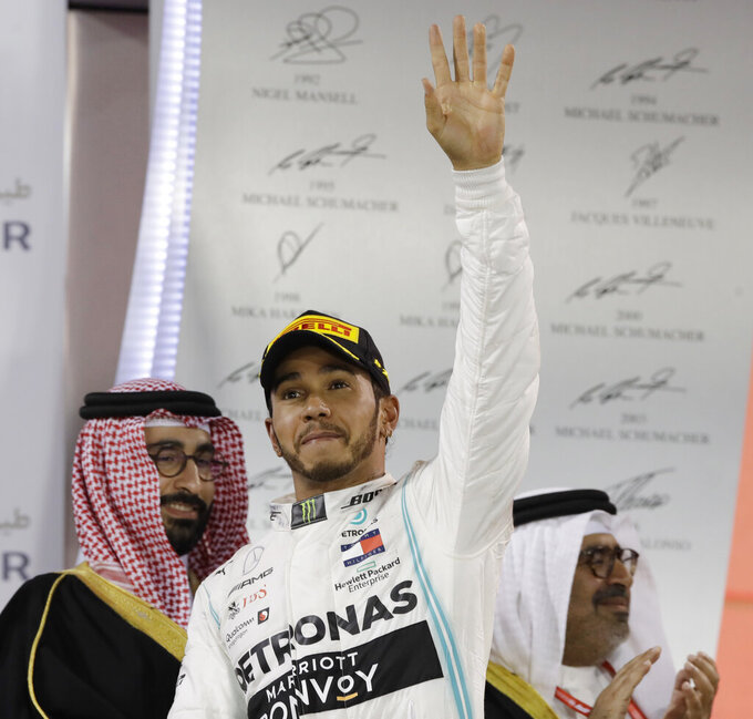 Mercedes driver Lewis Hamilton of Britain celebrates his victory at the end of the Baharain Formula One Grand Prix at the Bahrain International Circuit in Sakhir, Bahrain, Sunday, March 31, 2019. (AP Photo/Luca Bruno)