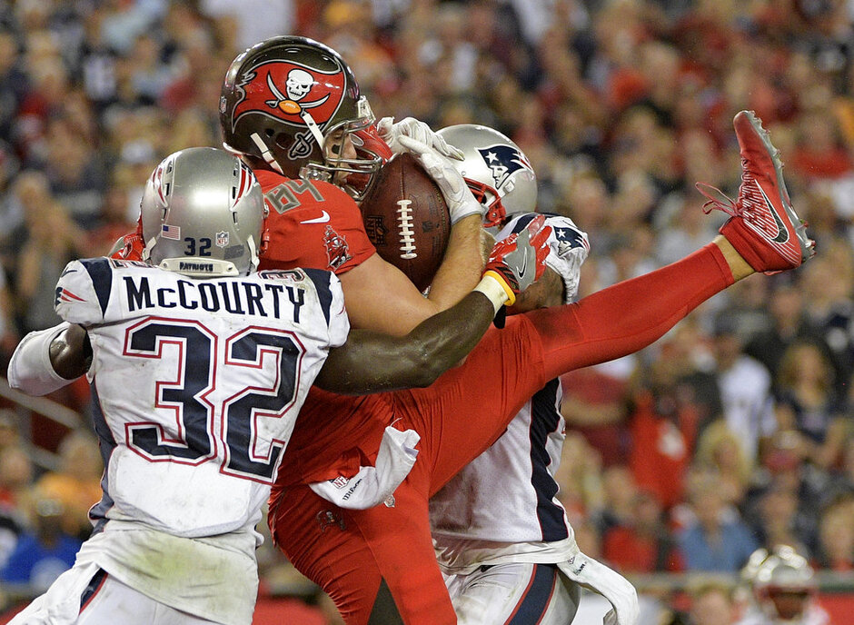 Cameron Brate, Devin McCourty, Patrick Chung