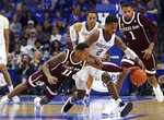 Kentucky's Ashton Hagans (2) chases a loose ball between Texas A&M's Wendell Mitchell (11) and Savion Flagg (1) during the second half of an NCAA college basketball game in Lexington, Ky., Tuesday, Jan. 8, 2019. Kentucky won 85-74. (AP Photo/James Crisp)