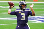 Seattle Seahawks quarterback Russell Wilson (3) warms up prior to an NFL football game against the San Francisco 49ers, Sunday, Jan. 3, 2021, in Glendale, Ariz. (AP Photo/Rick Scuteri)