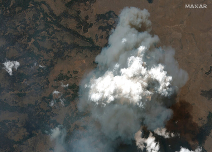 This satellite image provided by Satellite image ©2021 Maxar Technologies the Bootleg Fire in Oregon on Wednesday, July 21, 2021.   The Oregon fire, which was sparked by lightning, has ravaged the sparsely populated southern part of the state and had been expanding by up to 4 miles (6 kilometers) a day, pushed by strong winds and critically dry weather that turned trees and undergrowth into a tinderbox.  (Satellite image ©2021 Maxar Technologies via AP)