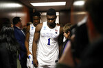 Duke forward Zion Williamson (1) walks out of the Duke locker room with teammate Tre Jones after an NCAA men's East Regional final college basketball game against Michigan State, Sunday, March 31, 2019, in Washington. (AP Photo/Patrick Semansky)