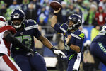 Seattle Seahawks quarterback Russell Wilson (3) passes against the Arizona Cardinals during the second half of an NFL football game, Sunday, Dec. 22, 2019, in Seattle. (AP Photo/Elaine Thompson)