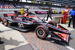 Will Power, of Australia, pulls into victory circle after winning the IndyCar auto race at Indianapolis Motor Speedway in Indianapolis, Saturday, Aug. 14, 2021. (AP Photo/Michael Conroy)