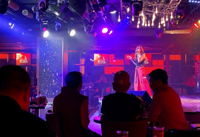 A singer performs at a nightclub in Dubai, United Arab Emirates, Nov. 5, 2020. On Thursday, Jan 21, 2021, Dubai's tourism authorities announced an immediate halt to all live music and shows at hotels and restaurants as coronavirus cases surged to unseen heights over recent weeks. The UAE also ordered the suspension of all non-urgent surgeries to deal with an influx of new COVID-19 patients. (AP Photo/Kamran Jebreili)
