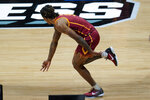 USC guard Isaiah White (5) celebrates a three-point basket against Kansas during the second half of a men's college basketball game in the second round of the NCAA tournament at Hinkle Fieldhouse in Indianapolis, Monday, March 22, 2021. (AP Photo/Paul Sancya)