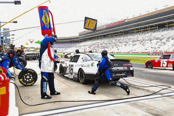 AJ Allmendinger makes a pit stop during the NASCAR Xfinity Series auto race Saturday, July 10, 2021, in Hampton, Ga. (AP Photo/John Amis)