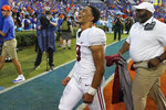 Alabama quarterback Bryce Young celebrates in front of fans as he leaves the field after defeating Florida in an NCAA college football game, Saturday, Sept. 18, 2021, in Gainesville, Fla. (AP Photo/John Raoux)