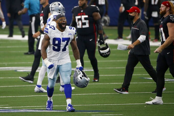 Dallas Cowboys defensive end Everson Griffen (97) celebrates their 40-39 win against the Atlanta Falcons in an NFL football game in Arlington, Texas, Sunday, Sept. 20, 2020. (AP Photo/Ron Jenkins)