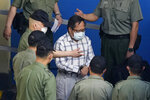 FILE - In this May 28, 2021, file photo, former pro-democracy lawmaker Albert Ho is escorted by Correctional Services officers to a prison van for a court in Hong Kong. Seven pro-democracy activists were on Wednesday, Sept. 1, given prison sentences of between 11 to 16 months in jail for their roles in an unauthorized assembly during the anti-government protests in 2019. The seven activists, which includes lawyer Albert Ho and Figo Chan, the former leader of the disbanded Civil Human Rights Front, had previously pleaded guilty to charges that included organizing and inciting others to take part in the unauthorized assembly on Oct. 20, 2019. (AP Photo/Kin Cheung, File)
