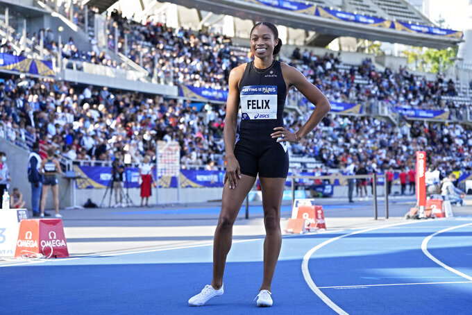 Allyson Felix, of the United States, smiles after finishing third in the women's 400 meters during the Meeting de Paris Diamond League athletics meet at Stade Charlety in Paris, Saturday, Aug. 28, 2021. (AP Photo/Francois Mori)