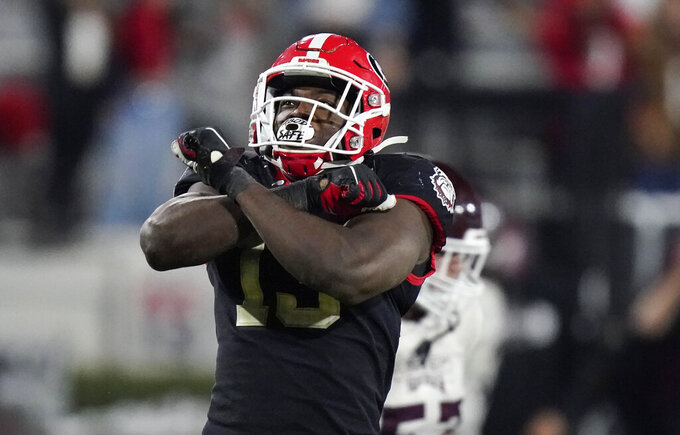 Georgia linebacker Azeez Ojulari (13) celebrates after a sack during the second half of an NCAA college football game against Mississippi State, Saturday, Nov. 21, 2020, in Athens, Ga. Ojulari was selected in the second round of the 2021 NFL football draft by the New York Giants. (AP Photo/Brynn Anderson)