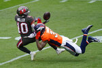 Tampa Bay Buccaneers wide receiver Scott Miller (10) make a catch as Denver Broncos free safety Justin Simmons defends during the first half of an NFL football game Sunday, Sept. 27, 2020, in Denver. (AP Photo/Jack Dempsey)