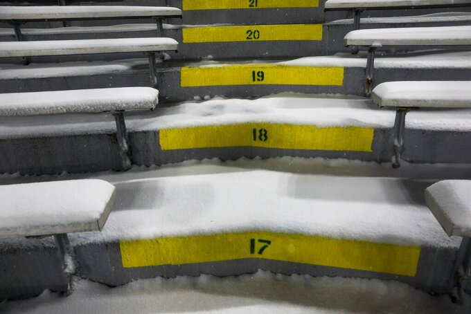 Snow fills the stands at Lambeau Field during the second half of an NFL football game between the Green Bay Packers and the Tennessee Titans Sunday, Dec. 27, 2020, in Green Bay, Wis. (AP Photo/Mike Roemer)