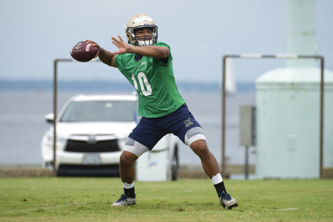 FILE - In this Aug. 2, 2019, file photo, Navy quarterback Malcolm Perry (10) looks to throw during NCAA college football training camp in Annapolis, Md. Much of the team's success could hinge on how well Perry is able to execute this offense. He completed nine of 25 pass attempts for 222 yards with two touchdowns and an interception over 13 games in 2018.(AP Photo/Tommy Gilligan, File)