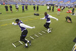 Baltimore Ravens' Marlon Humphrey, left, and Chris Smith practice their footwork during practice at NFL football training camp Saturday, July 31, 2021, in Baltimore. (AP Photo/Gail Burton)