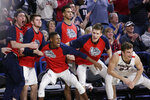 Players on the Gonzaga bench celebrate during the second half of an NCAA college basketball game against BYU in Spokane, Wash., Saturday, Feb. 23, 2019. Gonzaga won 102-68. (AP Photo/Young Kwak)