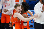 Syracuse's Buddy Boeheim and Quincy Guerrier hug following a second-round game against West Virginia in the NCAA men's college basketball tournament at Bankers Life Fieldhouse, Sunday, March 21, 2021, in Indianapolis. Syracuse defeated Syracuse 75-72. (AP Photo/Darron Cummings)