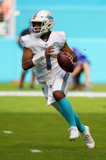 Miami Dolphins quarterback Tua Tagovailoa (1) looks to pass the ball, during the first half of an NFL football game against the Los Angeles Rams, Sunday, Nov. 1, 2020, in Miami Gardens, Fla. (AP Photo/Wilfredo Lee)