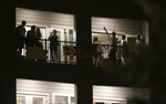 FILE - In this Sept. 1, 2020 file photo, partiers congregate on the balcony of a downtown apartment in Columbia, Mo., near the University of Missouri campus. College towns across the U.S. have emerged as coronavirus hot spots in recent weeks as schools struggle to contain the virus. In many cases, surges have been blamed on off-campus parties. The University of Missouri announced this week that it expelled two students and suspended three others for violating rules meant to slow the virus's spread. (Dan Shular/Missourian via AP, File)