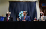 Lt. Governor Dan Patrick, left, Texas Gov. Greg Abbott, and Speaker Dennis Bonnen, right, attend a news conference where they provided an update to Texas' response to COVID-19, Thursday, Sept. 17, 2020, in Austin, Texas. (AP Photo/Eric Gay)