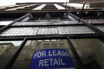 A sign advertising retail space hangs in the window of an empty storefront, in Boston's Downtown Crossing neighborhood, Sunday, Aug. 2, 2020. (AP Photo/Steven Senne)