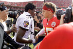 Kansas City Chiefs quarterback Patrick Mahomes, right, and Baltimore Ravens quarterback Lamar Jackson (8) greet each other after their NFL football game Sunday, Sept. 22, 2019, in Kansas City, Mo. (AP Photo/Charlie Riedel)