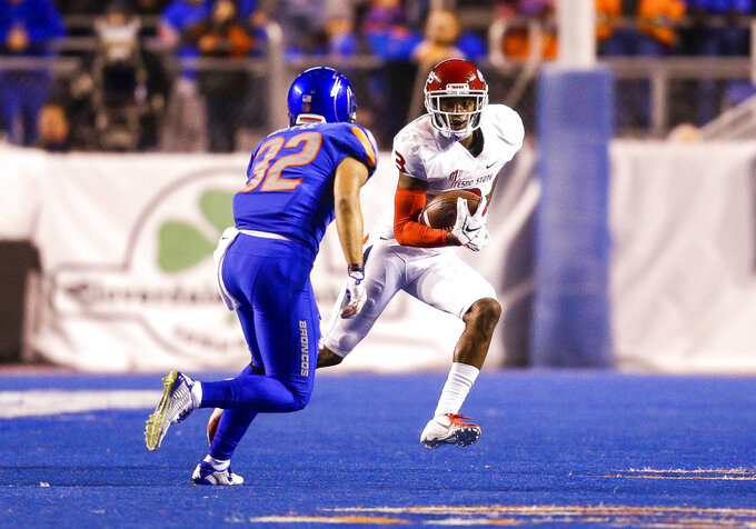Fresno State wide receiver KeeSean Johnson (3) runs with the ball after a reception in front of Boise State safety Jordan Happle (32) in the second half of an NCAA college football game, Friday, Nov. 9, 2018, in Boise, Idaho. Boise State won 24-17 over Fresno State. (AP Photo/Steve Conner)
