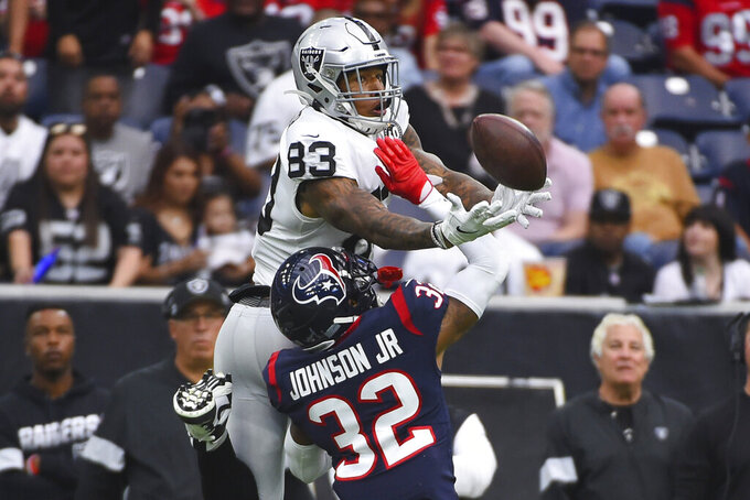 Houston Texans cornerback Lonnie Johnson (32) breaks up a pass intended for Oakland Raiders tight end Darren Waller (83) during the first half of an NFL football game Sunday, Oct. 27, 2019, in Houston. (AP Photo/Eric Christian Smith)