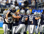 Dallas Cowboys kicker Greg Zuerlein (2) is lifted by teammates after making the game-winning field goal as time expired during the second half of an NFL football game against the Los Angeles Chargers Sunday, Sept. 19, 2021, in Inglewood, Calif. (AP Photo/Gregory Bull)