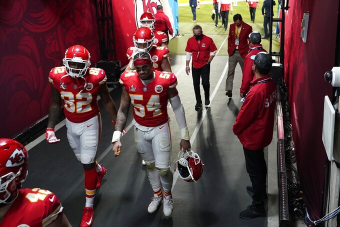 Kansas City Chiefs' Tyrann Mathieu (32) and Damien Wilson (54) walk to the locker room following of the NFL Super Bowl 55 football game Sunday, Feb. 7, 2021, in Tampa, Fla. The Buccaneers defeated the Chiefs 31-9 to win the Super Bowl. (AP Photo/David J. Phillip)