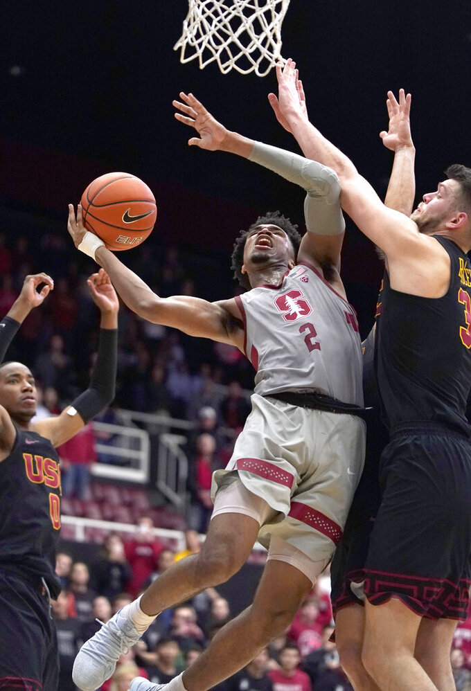 Stanford guard Bryce Wills (2) drives to the basket against Southern California forward Nick Rakocevic (31) during the second half of an NCAA college basketball game Wednesday, Feb. 13, 2019, in Stanford, Calif. Stanford won 79-76. (AP Photo/Tony Avelar)