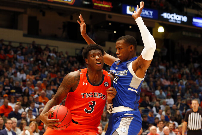Auburn forward Danjel Purifoy, left, drives the baseline around Saint Louis forward Javonte Perkins, right, during the second half of an NCAA college basketball game Saturday, Dec. 14, 2019, in Birmingham, Ala. (AP Photo/Butch Dill)