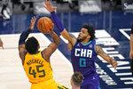 Utah Jazz guard Donovan Mitchell (45) shoots as Charlotte Hornets forward Miles Bridges (0) defends in the second half during an NBA basketball game Monday, Feb. 22, 2021, in Salt Lake City. (AP Photo/Rick Bowmer)