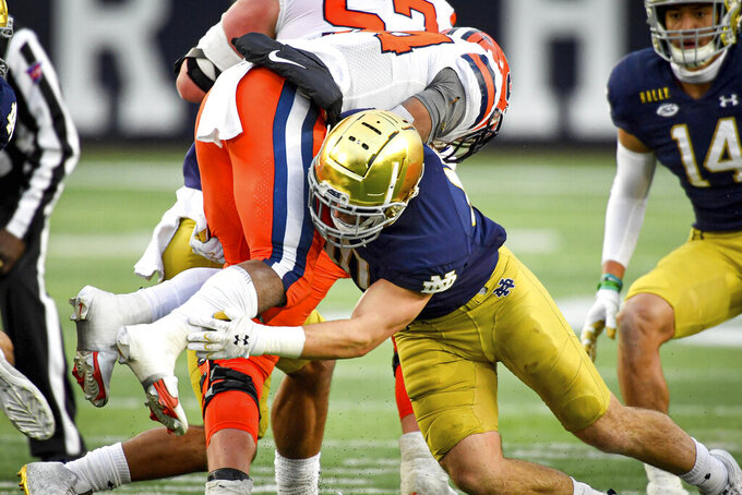 Syracuse running back Sean Tucker (34) is tackled by Notre Dame linebacker Drew White (40) in the second half of an NCAA college football game Saturday, Dec. 5, 2020, in South Bend, Ind. (Matt Cashore/Pool Photo via AP)