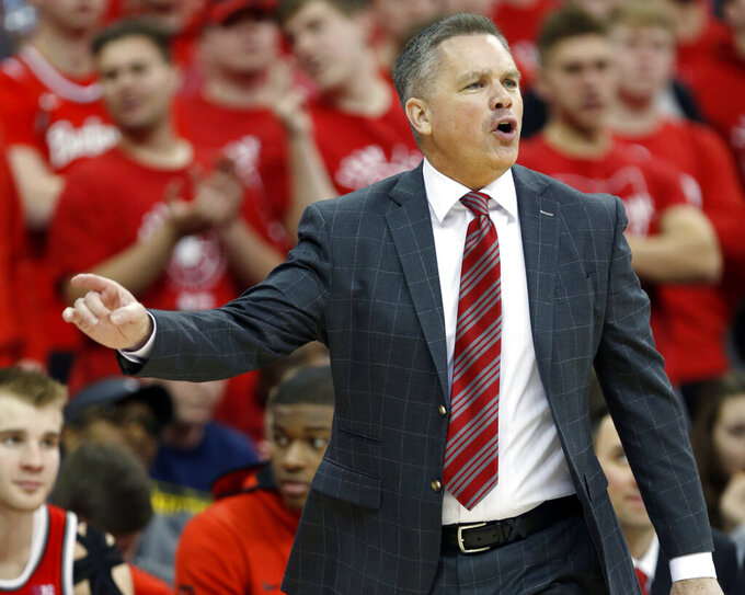 FILE - In this March 1, 2020, file photo, Ohio State coach Chris Holtmann directs his team against Michigan during the second half of an NCAA college basketball game in Columbus, Ohio. Transfer rules have generated a lot of comings and goings in the Ohio State basketball program. Add a preseason practice schedule affected by COVID-19 restrictions, and it's no wonder coach Chris Holtmann is still trying to figure out where all the pieces will fit. (AP Photo/Paul Vernon, File)