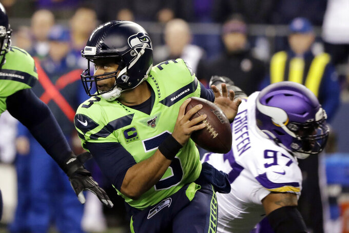 Seattle Seahawks quarterback Russell Wilson (3) scrambles against the Minnesota Vikings during the first half of an NFL football game, Monday, Dec. 2, 2019, in Seattle. (AP Photo/Ted S. Warren)