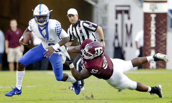Kentucky quarterback Terry Wilson (3) is caught for a sack by Texas A&M defensive lineman Justin Madubuike (52) during the first half of an NCAA college football game Saturday, Oct. 6, 2018, in College Station, Texas. (AP Photo/Michael Wyke)