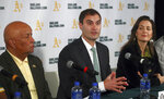 FILE - In this Nov. 28, 2018, file photo Oakland Athletics President Dave Kaval, center, speaks beside Oakland Mayor Libby Schaaf, right, and Ces Butner, president of the Board of Port Commissioners, during a news conference in Oakland, Calif. The Oakland City Council approved Tuesday, July 20, 201, preliminary terms for a new $12 billion waterfront ballpark project for the Athletics. But it's not clear if the 6-1 vote will be enough to keep the A's at the negotiating table instead of leaving the city. Schaaf and city council leaders praised the vote as marking a milestone in negotiations. Kaval said that the financial terms do not work for the team. (AP Photo/Ben Margot, FIle)