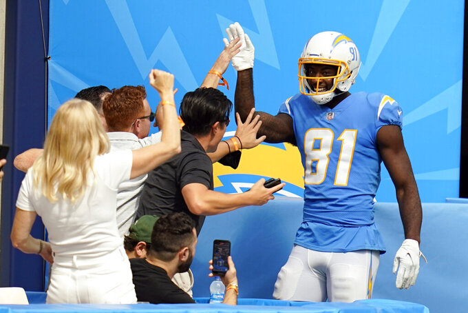 Los Angeles Chargers wide receiver Mike Williams celebrates his touchdown catch with fans during the first half of an NFL football game against the Cleveland Browns Sunday, Oct. 10, 2021, in Inglewood, Calif. (AP Photo/Gregory Bull)