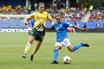 Brazil's Marta, right, tussles for the ball with Australia's Emily Gielnik during the Women's World Cup Group C soccer match between Australia and Brazil at Stade de la Mosson in Montpellier, France, Thursday, June 13, 2019. (AP Photo/Claude Paris)