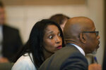 Former judge Tracie Hunter speaks to one of her lawyers in the courtroom of Hamilton County Common Pleas Judge Patrick T. Dinkelacker on Monday, July 22, 2019 in Cincinnati. Hunter was ordered to serve a six-month jail sentence that was imposed more than four years ago. Hunter, 52, had gone to multiple courts to challenge her 2014 conviction and sentence on a felony count of unlawful interest in a public contract, which charged that she provided a confidential document to her brother when he faced a disciplinary hearing in his court job.  (Albert Cesare/The Cincinnati Enquirer via AP)