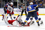 Columbus Blue Jackets goaltender Elvis Merzlikins, of Latvia, dives after a puck controlled by St. Louis Blues' Sammy Blais (9) during the second period of an NHL hockey game Friday, Nov. 1, 2019, in St. Louis. (AP Photo/Jeff Roberson)