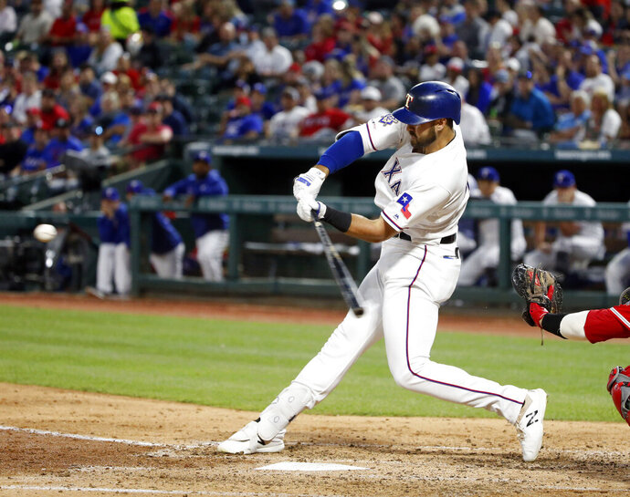 Texas Rangers' Joey Gallo hits a solo home run against the Los Angeles Angels during the third inning of a baseball game Monday, April 15, 2019, in Arlington, Texas. (AP Photo/Michael Ainsworth)