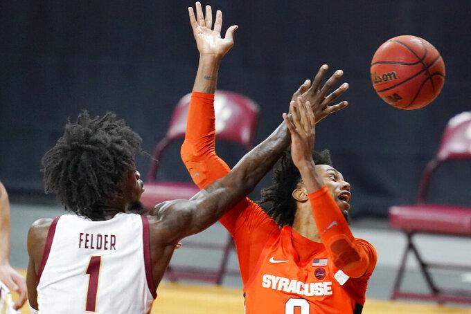 Boston College forward CJ Felder (1) knocks the ball away from Syracuse forward Alan Griffin (0) during the second half of an NCAA college basketball game, Saturday, Dec. 12, 2020, in Boston. Syracuse won 101-63. (AP Photo/Elise Amendola)