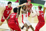 Houston's Tramon Mark (12) ends up in the middle of a group of Rutgers defenders during the first half of a college basketball game in the second round of the NCAA tournament at Lucas Oil Stadium in Indianapolis Sunday, March 21, 2021. (AP Photo/Mark Humphrey)