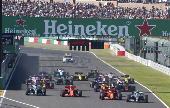 FILE - In this Oct. 13 2019, file photo, Mercedes driver Valtteri Bottas, right, of Finland passes Ferrari driver Sebastian Vettel of Germany at the start of the Japanese Formula One Grand Prix at Suzuka Circuit in Suzuka, central Japan. The 2021 Japanese Grand Prix has been canceled following discussions between the government and race promoters, Formula One organizers said Wednesday, Aug. 18, 2021.(AP Photo/Toru Hanai, File)