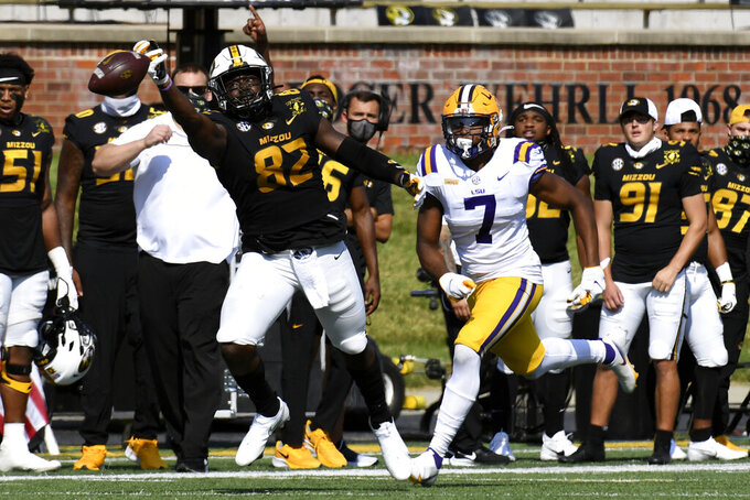 Missouri tight end Daniel Parker Jr. (82) reaches for a pass as LSU safety JaCoby Stevens (7) defends during the first half of an NCAA college football game Saturday, Oct. 10, 2020, in Columbia, Mo. (AP Photo/L.G. Patterson)