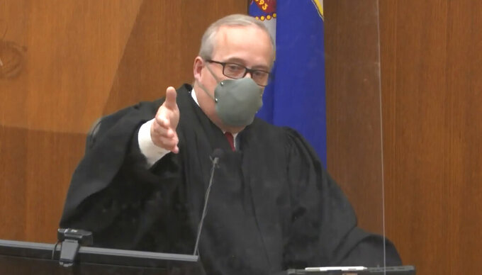 In this screen grab from video, Hennepin County Judge PeterCahill presides over jury selection, Tuesday, March 23, 2021, in the trial of former Minneapolis police officer Derek Chauvin, in the May 25, 2020, death of George Floyd at the Hennepin County Courthouse in Minneapolis, Minn. (Court TV via AP, Pool)