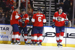 Florida Panthers defenseman Mark Pysyk (13) celebrates with teammates after scoring during an NHL hockey game against the Vancouver Canucks, Thursday, Jan. 9, 2020, in Sunrise, Fla. (AP Photo/Brynn Anderson)